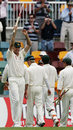 Glenn McGrath raises a stump in celebration after Australia trounce England at Brisbane, Australia v England, 1st Test, Brisbane, November 27, 2006