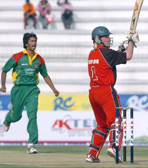 Brendan Taylor looks back as he is caught off  Shahadat Hossain