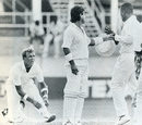 Allan Lamb steps between a rowing Alec Stewart and Desmond Haynes