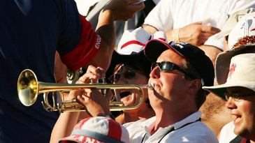 Bill Cooper, the Barmy Army trumpeter, plays a tune in the WACA crowd