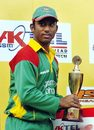 Aftab Ahmed holds the Man Of The Series trophy after Bangladesh's 2-0 win over Scotland
