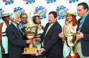 Trinidad and Tobago Cricket president and West Indies Cricket Board representative Deryck Murray, left, receives the Carib International Challenge Trophy from Carib CEO Andrew Sabga at the launch of the 2007 Carib Beer Series at Crowne Plaza, Trinidad, December 29, 2006
