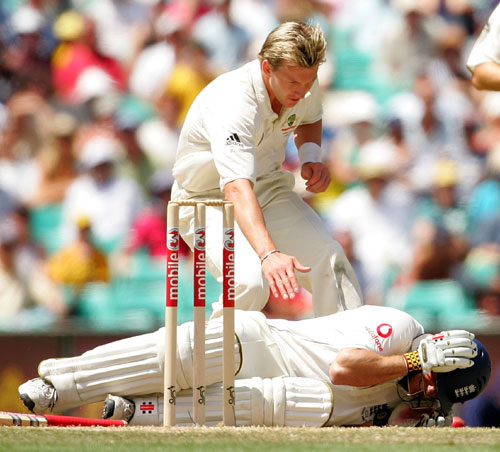 Despite the padding and protection, a ball made of cork covered in leather and lacquer, weighing 156g and travelling at 100mph will fell a batsman. Here Brett Lee checks out his latest victim.