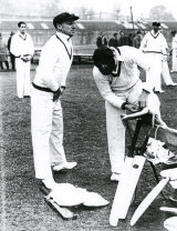 Don Bradman, 'box' in position, prepares to tune up in the nets at the start of the tour © Wisden Cricket Monthly