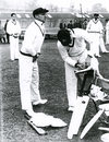 Don Bradman, 'box' in position, prepares to tune up in the nets at Lord's, 1948. Behind him, waiting to bowl, are Ernie Toshack (left) and Doug Ring, Lord's, May 1948
