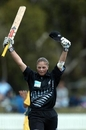 Rebecca Rolls salutes the crowd after reaching her maiden ODI century against Australia
