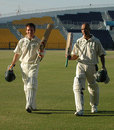 Eoin Morgan and Andre Botha walk off after their record stand