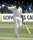 Clive Lloyd ushers fans off the field during his hundred in the 1975 World Cup final