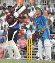 Collis King smashes a six as Alec Stewart watches on at the opening of the new Kensington Oval, West Indies All Stars v World XI, Barbados, February 17, 2007