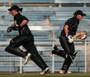 Maria Fahey and Helen Watson of New Zealand cross over for a single,New Zealand v India, ICC Quadrangular Tournament, Chennai, February 25, 2007