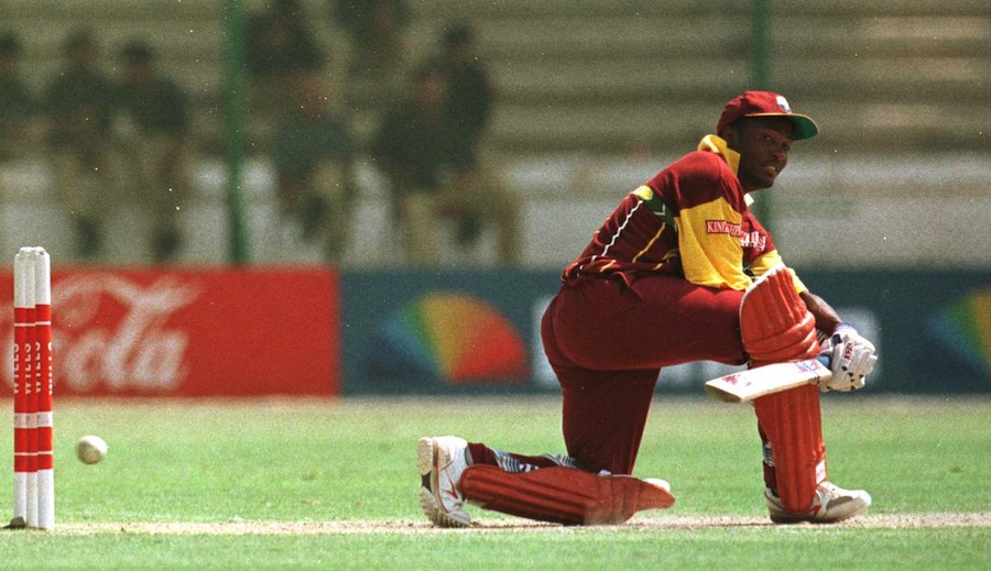 Brian Lara sweeps during his hundred