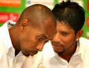 Ian Bradshaw listens to Ramnaresh Sarwan during a press conference,  in Montego Bay, March 5, 2007