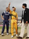 Ricky Ponting throws the coin in the air and Scotland captain Craig Wright calls right