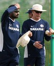 Harbhajan Singh and Greg Chappell have a chat during India's practice session at Couva