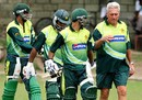 Top-order trouble: Bob Woolmer in consultation with Imran Nazir, Mohammad Hafeez  and Younis Khan during a practice session in Kingston, Jamaica, March 15, 2007