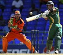 Herschelle Gibbs goes for a heave over long-off as a frightened Jeroen Smits looks on