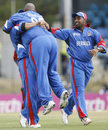 Dwayne Leverock is lifted off his feet by Irvine Romaine as Kwame Tuckerlooks on after a stunning one-handed catch to dismiss Robin Uthappa, Bermuda v India, Group B, Trinidad, March 19, 2007