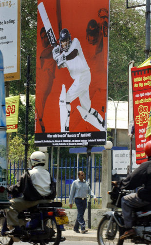 A man walks past a billboard depicting Sri Lanka's captain Mahela Jayawardene, Colombo, March 28, 2007