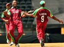 Corey Collymore celebrates the wicket of Graeme Smith with Brian Lara
