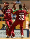 Brian Lara congraulates Corey Collymore on getting the wicket of Graeme Smith