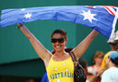 An Australia fan holds aloft her country's flag after their crushing nine-wicket win, Australia v Ireland, Super Eights, Barbados, April 13, 2007