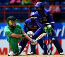 Kenneth Carroll looks back to see his stumps displaced, Ireland v Sri Lanka, Super Eights, National Stadium, Grenada, April 18, 2007