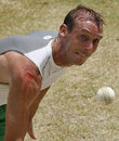 Paul Mooney, with a bloody arm, roars into bowl during a net session, Guyana, April 8, 2007