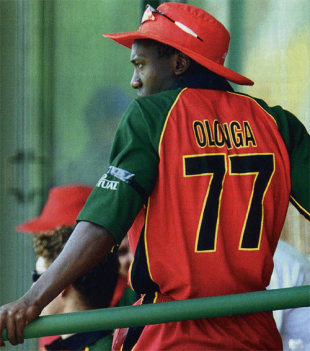 Henry Olonga wears a black armband in protest while in the players' enclosure,  Zimbabwe v Namibia, Harare, 10 February 2003