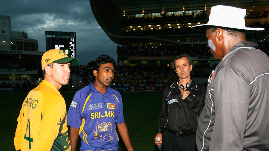 Ricky Ponting and Mahela Jayawardene speak to the umpires about the chaotic scenes at the end of the final