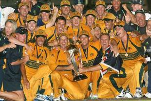 The Australians celebrate with the World Cup trophy