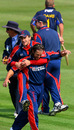 Mark Turner and Peter Trego celebrate Chris Adams's wicket