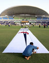 Last-minute preparations to the pitch ahead of the opening game, Abu Dhabi, May 17, 2007