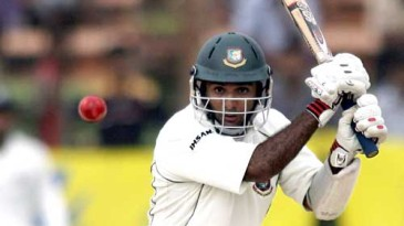 Javed Omar drives during his unbeaten knock of 52
