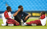 Michael Holding talks with Daren Powell (left) and Jerome Taylor, Headingley, May 24, 2007