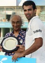 Zaheer Khan accepts the Man of the Match award after bowling India to victory in the second Test against Bangladesh, Bangladesh v India, 2nd Test, 3rd day, Mirpur, May 27, 2007