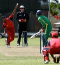 Khalid Khan bowls against Tanzania. Tracy Village, ICC WCL Division 3 Group B match, 30.05.2007