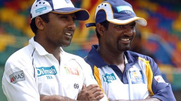 Mahela Jayawardene and Muttiah Muralitharan look on during the prize distribution ceremony