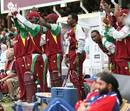 The West Indian dug-out applauds the efforts of their batsmen
