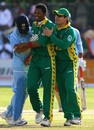 Makhaya Ntini is congratulated by Morne Van Wyk after dismissing Sachin Tendulkar early