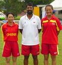 China's coach Rashid Khan with left, vice-captain Liu Bi Yu and right, captain Mei Chun Hua