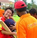 China's coach Rashid Khan congratulates Hu Ting Ting for her match-winning effort