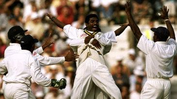 Muttiah Muralitharan took 16 wickets to bowl Sri Lanka to a ten-wicket win
