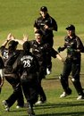 Sarah Tsukigawa is congratulated by her team-mates after picking up a wicket, Australia women v New Zealand women, 2nd ODI, Darwin, July 22, 2007
