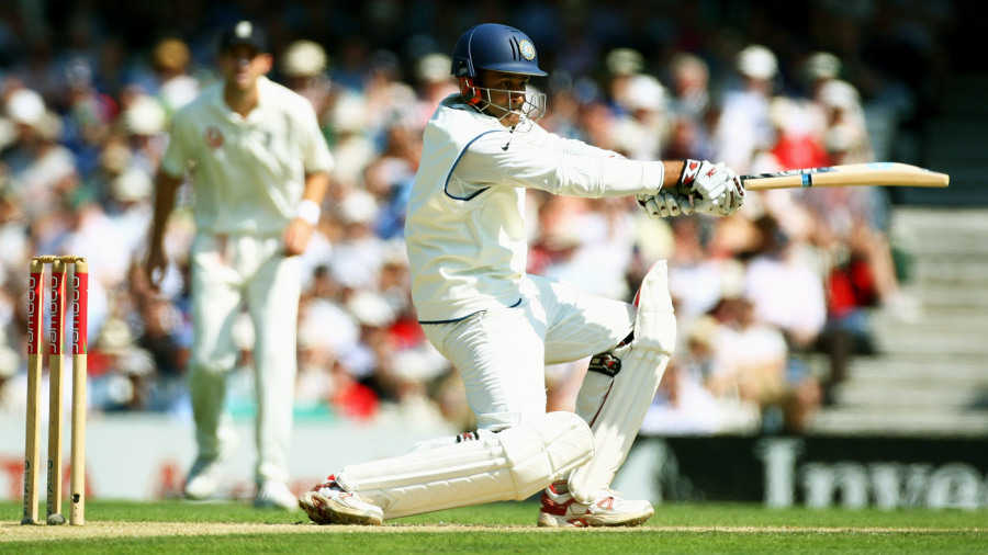 Anil Kumble crouches to drive