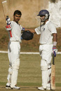 Subramaniath Badrinath is congratulated by Arjun Yadav on his hundred