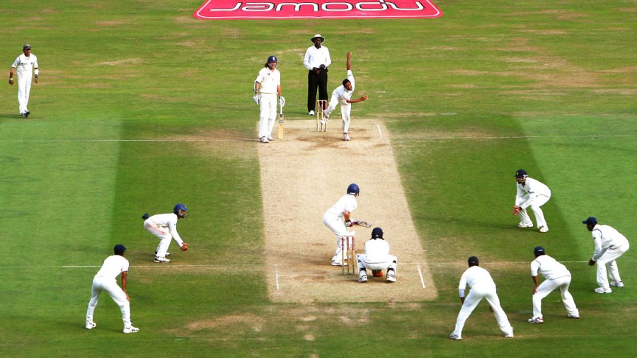 Anil Kumble runs in to bowl with the close-in fielders waiting to pounce on a catch