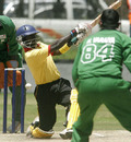Joel Olwenyi misses a shot as Kenya's bowler Hiren Varaiya looks on, Kenya v Uganda, 3rd match, Twenty20 Quadrangular, Nairobi, September 2, 2007