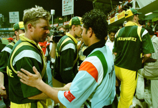 Shane Warne greets Sachin Tendulkar after India's victory in the final, Australia v India, Sharjah, April 24, 1998