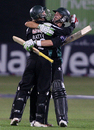 Gareth Batty and Stephen Moore embrace after taking Worcestershire to victory