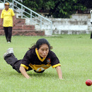 Champa Chakma dives towards the ball during a practice session